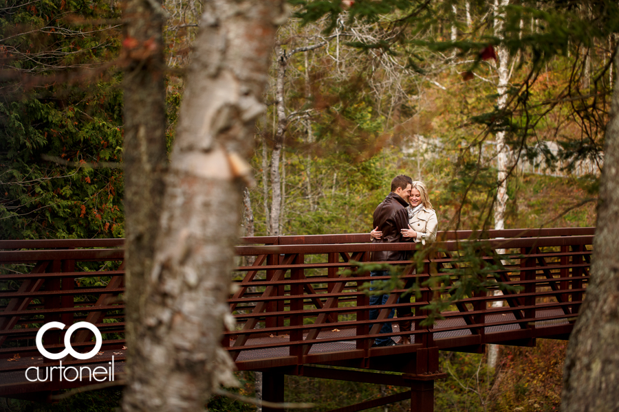 Sault Ste Marie Engagement Photography - Sarah and Marc - Fort Creek, sneak peek, fall, trees, bridge, cold