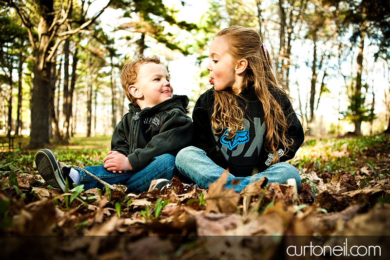 Kids Shoot - Camille and Chase sitting in the leaves