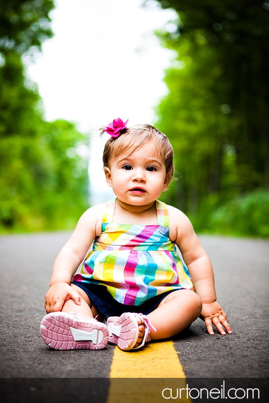 Macy at 9 months - baby photography - on the bike trail
