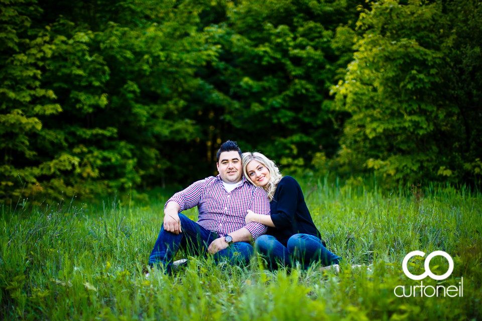 Kara and Tyler - Engagement sneak peek, sitting in field