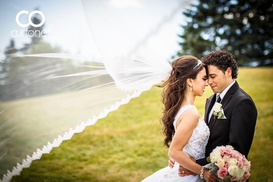 Emma and Anthony - Sault Wedding - sneak peek - Climbing a hill at Bellevue Park