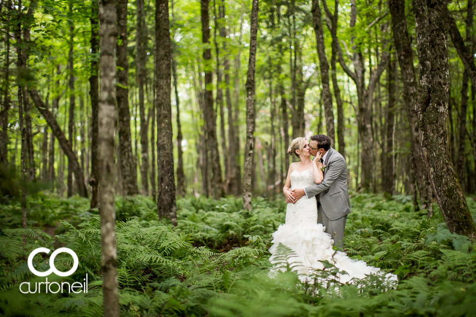 Jessyka and Eric Sault Wedding sneak peek under the canopy in the rain